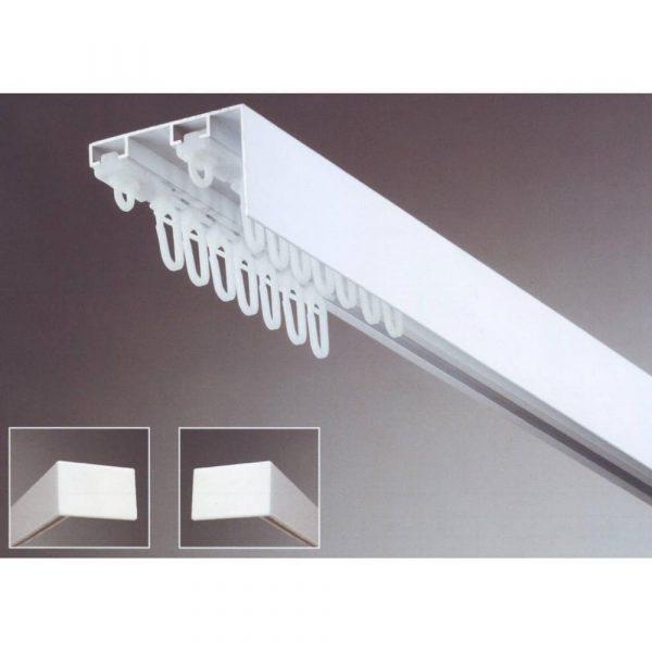 Záclonová kolejnice s krycím čelem pro montáž na strop s širší roztečí mezi drážkami.